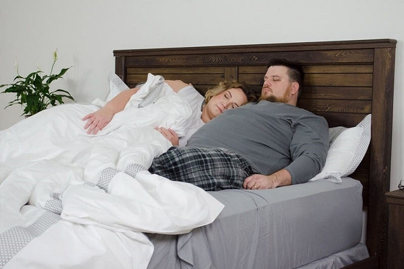 fat couples on bed
